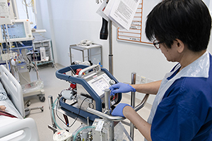 Vicky Scollen, staff nurse on the adult intensive care unit, using the ECMO equipment