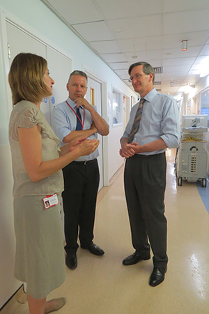 Dominic Grieve MP speaks to consultant paediatrician Dr Margarita Burmester and medical director Dr Richard Grocott-Mason during his visit to Royal Brompton