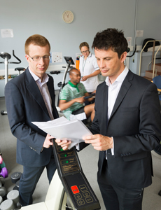Dr James Hull (right) with colleagues in the exercise lab