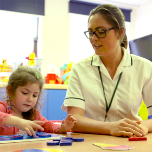 Occupational therapist working with a paediatric patient