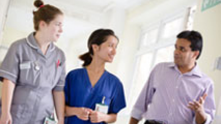 Hospital staff walking down a corridor